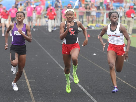 Sekayi Bracey from East Kentwood high school wins the 100 meter dash in front of Tamea McKelvy from Oak Park and Torisa Johnson from Ann Arbor Pioneer at the MHSAA Divison One State Track and Field championships on Saturday, June 4, 2016 at Hudsonville Eagles Stadium in Hudsonville, MI.