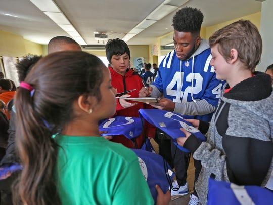 Indianapolis Colts player Kenny Moore II signs autographs at the Peace Learning Center, Tuesday, Nov. 28, 2017.  Members of the Indianapolis Colts and IMPD visited the center to work with 50 sixth graders from IPS #34, Eleanor Skillen School, doing team-building sessions designed to teach safe and simple ways to manage anger, solve problems and develop an understanding of differing perspectives.