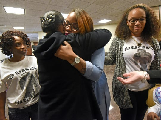 Taisha Mercado, Nate's mother, gets a hug as her sister, Kaisha Siner (right), and friend Lisa Taylor Hardwick look on after the arraignment of Casche Alford. Nate was Camden's first homicide victim in 2016.