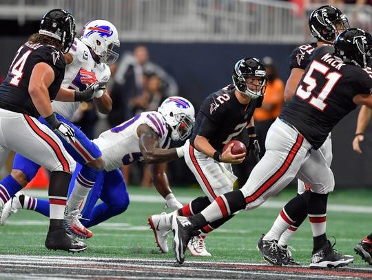 Atlanta Falcons quarterback Matt Ryan (2) is hit by