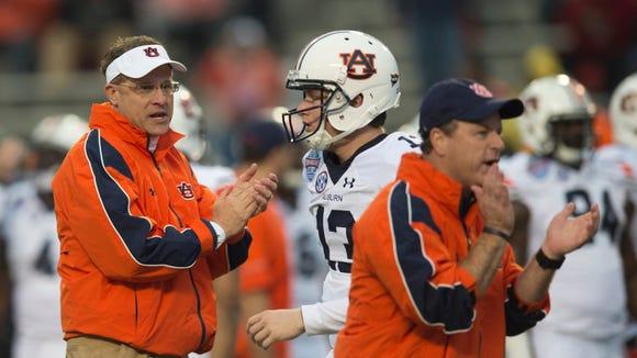 Auburn head coach Gus Malzahn claps as Auburn quarterback