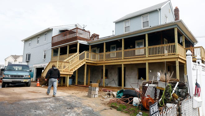 A construction worker was injured at this house raising site at 10 John Street in Highlands Monday, March 28, 2016, when he was struck in the head by a lally column.