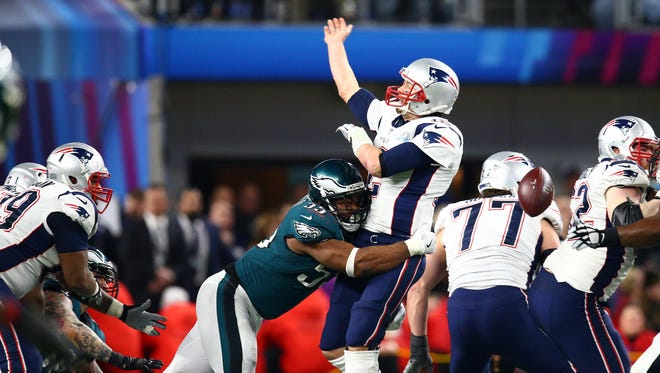 Eagles defensive end Brandon Graham sacks Patriots quarterback Tom Brady, forcing a crucial fumble late in the fourth quarter in Super Bowl LII at U.S. Bank Stadium. The Eagles recovered.
