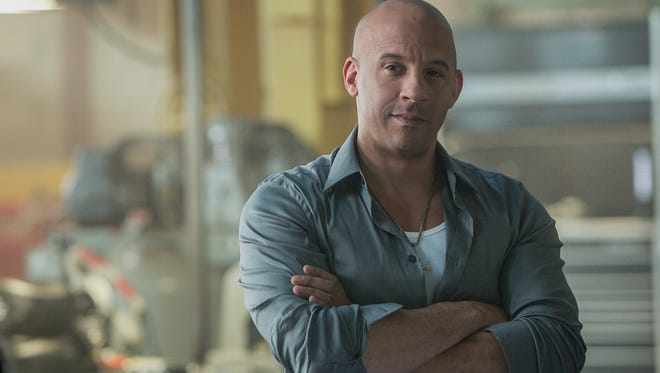 "This photo provided by Universal Pictures shows, Vin Diesel as Dom Toretto in a scene from ""Furious 7."""