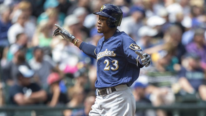 The Brewers' Keon Broxton celebrates the first  of his two home runs Sunday, Aug. 21 against the Mariners in Seattle. The Brewers won, 7-6.