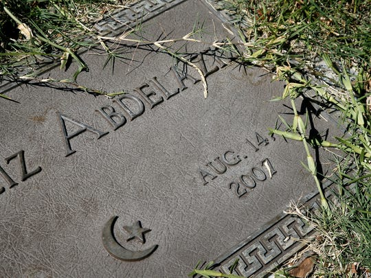 A grave marker with a family name sits planted in the Islamic Garden, a burial site for members of the Muslim faith, that is part of the Restland Cemetery Friday, July 17, 2015, in Dallas.