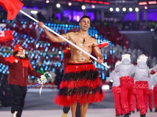 Pita Taufatofua leads the delegation from Tonga