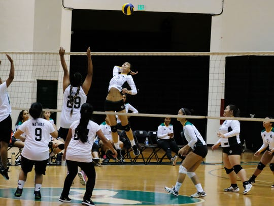 UOG's Lori Okada spikes against Pacific Islands University in their Guam Women's College Volleyball League game Thursday night, Feb. 2, 2017, at the UOG Calvo Field House. UOG won 3-1.