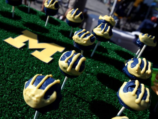 Rebecca Rudnick, 29, of Ann Arbor spent two hours making 22 Cake Pops in the Michigan football helmet for a tailgating party in 2011.