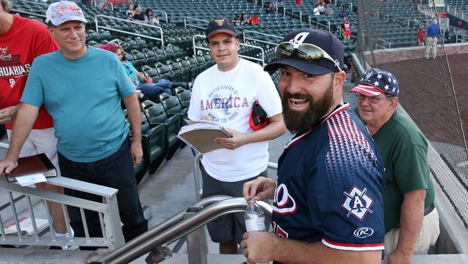 Reno Aces first baseman Cody Decker talks with fans in April 2018 during his return to Southwest University Park.
