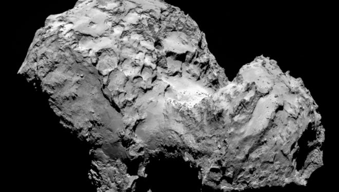 In this picture taken on Aug. 3, 2014 by Rosetta?s OSIRIS narrow-angle camera Comet 67P/Churyumov-Gerasimenko is pictured from a distance of 285 kms. A mission to land the first space probe on a comet reaches a major milestone when the unmanned Rosetta spacecraft finally catches up with its quarry on Wednesday Aug 6, 2014. It's a hotly anticipated rendezvous: Rosetta flew into space more than a decade ago and had to perform a series of complex maneuvers to gain enough speed to chase down the comet on its orbit around the sun. The image resolution is 5.3 metres/pixel. (AP Photo/ESA/Rosetta/MPS for OSIRIS Team )