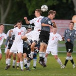 Plymouth's Calvin McCracken (right) closes in on Canton's Jack Zemanski during Tuesday night's game.