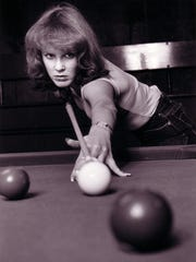 Vicki Paski, taking a shot at the pool table in 1980. The Grand Ledge resident is the last charter member of the Women's Professional Billiard's Association playing in tour competitions.