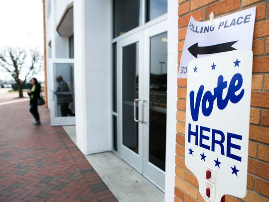 Voters leave the William Penn High polling place after