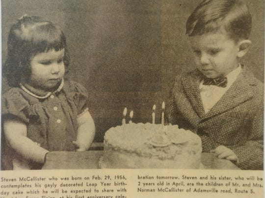 A young Steve McCallister contemplates his birthday cake in a 1960 newspaper clipping. At left is his little sister Susan Elaine.