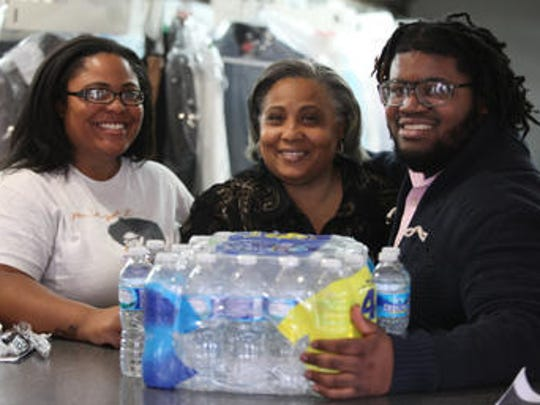 Ta'Tra Bradshaw-Brown, Denise Bradshaw and Shakeem Nottingham recently returned from a trip from Flint, Michigan, where they delivered 137 cases a water and plan to take more.