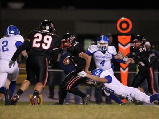 Wisconsin Rapids Assumption's Zach Krings dives as