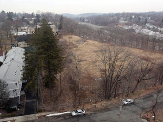 A portion of the old Good Counsel property in White Plains, where developers plan a large residential complex, as seen from the top of the Stewart Place condominium, Feb. 23, 2017. At right, I-287 can be seen.