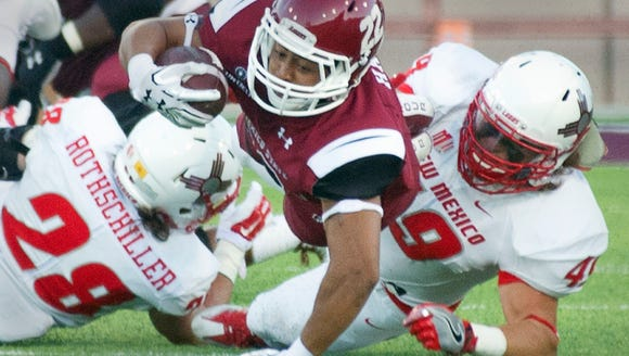 Aggies running back Xavier Hall keeps the play alive