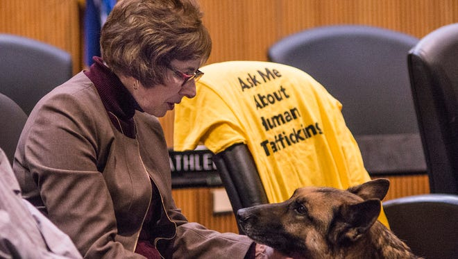 State Sen. Judy Emmons with Maverick, who works with Redford Township Police Officer Jen Mansfield. Emmons has made human trafficking a major focus of her Senate career.
