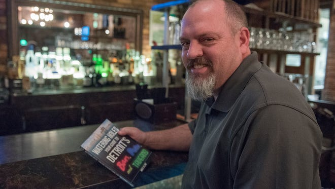 """Canton author Mike Kline visited 157 Detroit bars to pen his new guide, """"Watering Holes: You Guide To Detroit's Bars, Pubs and Taverns."""""""