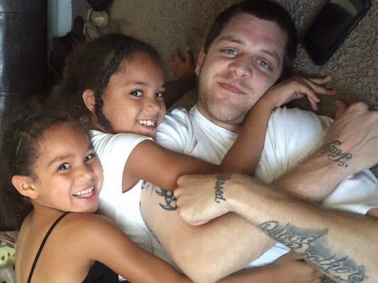 Former Syracuse University baskeball star Eric Devendorf has two daughters, Miranda, left, 7, and Madelyn, 9. He lives with them and their mother in Syracuse.