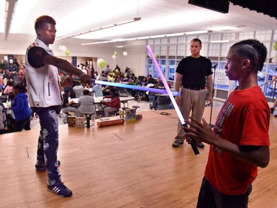 Morgan Ore and Brice Vaughn practice fencing skills