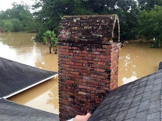 The water rose to the roof at Kemberley Corbitt's Denham Springs home.