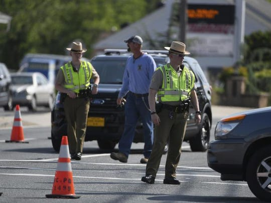 Maryland State Police divert traffic at Belair Road and Chapel Road after a Baltimore County officer was killed in Perry Hall, Md., May 21, 2018.