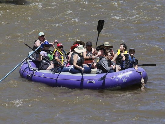 A raft filled with Riverfest visitors floats down the Animas River during last year's Riverfest.