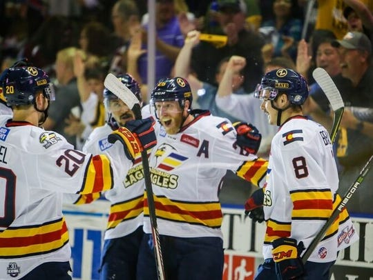 Colorado Eagles players celebrate a goal on their way