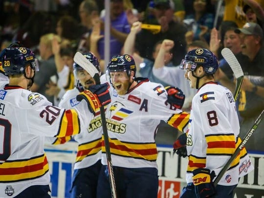 Colorado Eagles players celebrate a goal on their way to a 4-2 win over Florida in Wednesday's Game 6 at the Budweiser Events Center.