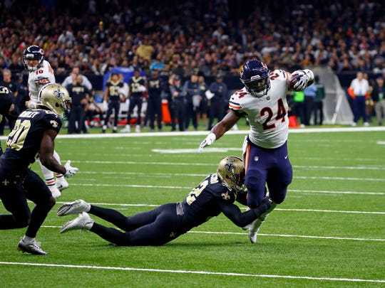New Orleans Saints strong safety Kenny Vaccaro tries to tackle Chicago Bears running back Jordan Howard (24) in the first half of an NFL football game in New Orleans, Sunday, Oct. 29, 2017.