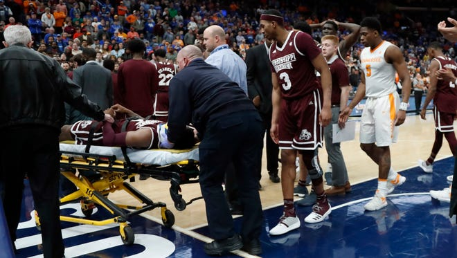 Mississippi State's Nick Weatherspoon is taken off on a stretcher after being injured during the second half of an NCAA college basketball quarterfinal game against Tennessee at the Southeastern Conference tournament Friday, March 9, 2018, in St. Louis. (AP Photo/Jeff Roberson)
