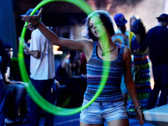 Micayla Walker dances with a hula hoop during DigiMusic, a free concert beneath the Texas Street bridge featuring Ken Ward of The Crystal Method on Thursday evening, which marked the end of the 2014 DigiFest South event.