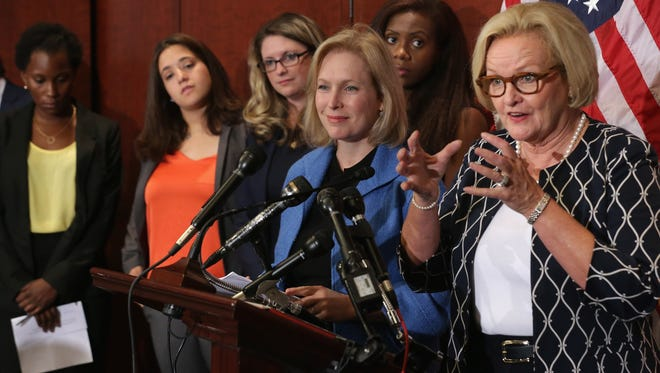 Sen. Claire McCaskill (D-MO) (R) and Sen. Kristen Gillibrand (D-NY) are joined by survivors of campus sexual assult during a news conference about new legislation aimed at curbing sexual assaults on college and university campuses at the U.S. Capitol Visitors Center July 30, 2014 in Washington, DC. With strong bipartisan support in the Senate, the bill would require schools to make public the result of anonymous surveys about campus assaults and impose significant financial burdens on universities that fail to comply with some of the law's requirements.