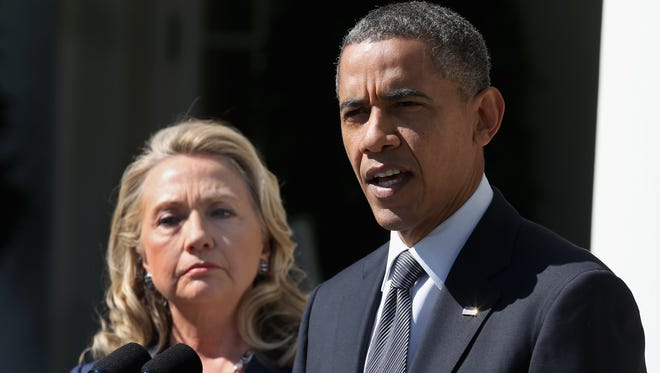 President Obama appears with then-Secretary of State Hillary Clinton in the Rose Garden at the White House  on Sept. 12, 2012.