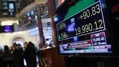 Stocks snap losing streak as Trump sworn in