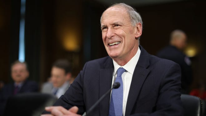Former senator Dan Coats prepares to testify during his confirmation hearing before the Senate Intelligence Committee on Feb. 28, 2017.