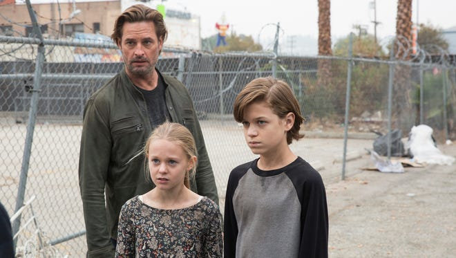 Josh Holloway as Will Bowman, Isabella Crovetti-Cramp as Grace Bowman, and Jacob Buster as Charlie Bowman in USA's 'Colony.'
