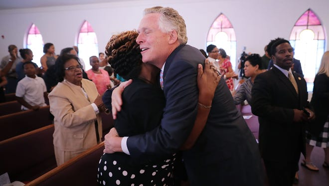 Virginia Gov. Terry McAuliffe greets churchgoers during a worship service at Mt. Zion First African Baptist Church on Aug.13, 2017 in Charlottesville, Virginia. McAuliffe addressed the congregation the day after violence erupted around the Unite the Right rally, a gathering of white nationalists, neo-Nazis, the Ku Klux Klan and members of the 'alt-right,' that left one counter-protester and two state police officers dead.