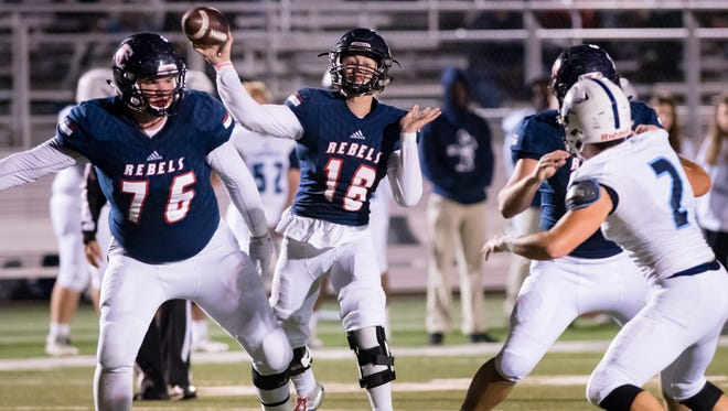 Teurlings Catholic offensive tackle Thomas Perry (76) protects former Rebels quarterback Wesley Blazek (18) during Teurlings' playoff victory against Loyola Prep on Nov. 10, 2017.