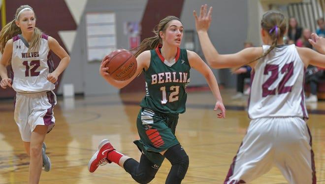 Mackenzie Kurczek (12) of Berlin drives to the basket against Winneconne on Feb. 13.