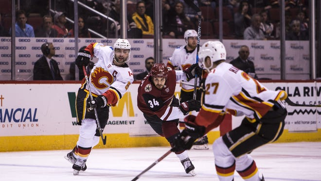 Coyotes center Zac Rinaldo chases the puck against the Flames in the 1st period on Thursday, Feb. 22, 2018 at Gila River Arena in Glendale, Ariz.