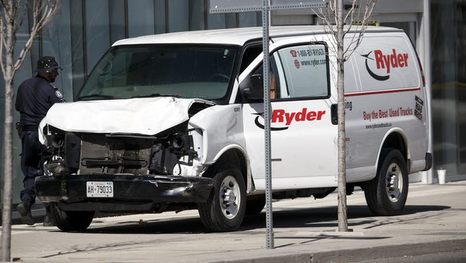 Police inspect a van suspected of being involved in a collision injuring at least eight people at Yonge St. and Finch Ave. on April 23, 2018 in Toronto, Canada. A suspect is in custody after a white van collided with multiple pedestrians.