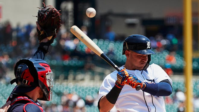May 16, 2018; Detroit, MI, USA; Detroit Tigers shortstop Jose Iglesias (1) avoids an inside pitch in the third inning against the Cleveland Indians at Comerica Park. Mandatory Credit: Rick Osentoski-USA TODAY Sports