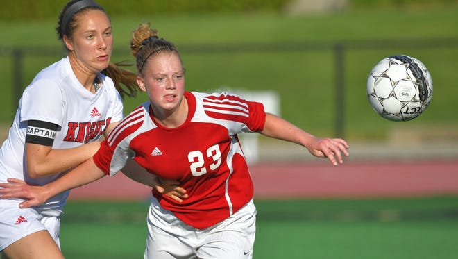 Maggie Berenz (23) of Lourdes and Jaida Heinz (23) of Newman go after the ball. The Lourdes Academy Knights hosted the Newman Catholic Cardinals Thursday evening, May 31, 2018 in a WIAA Regional soccer match at J.J. Keller Field at Titan Stadium.