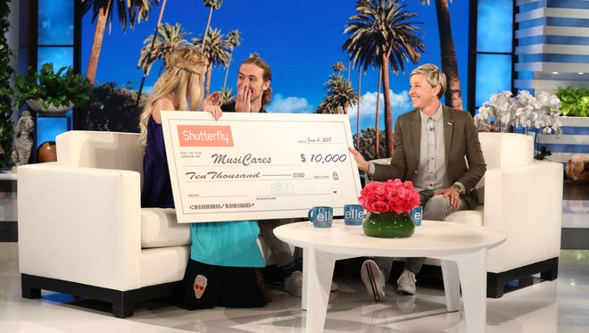 "From left, Kristi Platillero, David Francisco and host Ellen DeGeneres appear on ""Ellen"" Monday, June 4."