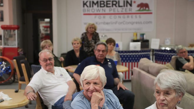 Members of the East Valley Republican Women Federated Club listen to election results in La Quinta, Calif., Tuesday,  June 5, 2018.