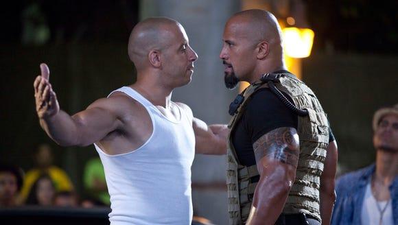 Vin Diesel, left, and Dwayne Johnson in a scene from